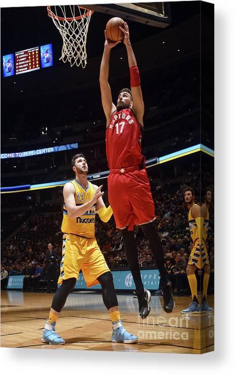Nba Pro Basketball Canvas Print featuring the photograph Toronto Raptors V Denver Nuggets by Garrett Ellwood
