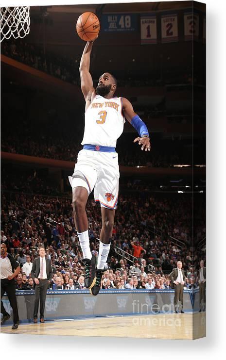 Tim Hardaway Jr. Canvas Print featuring the photograph Milwaukee Bucks V New York Knicks by Ned Dishman