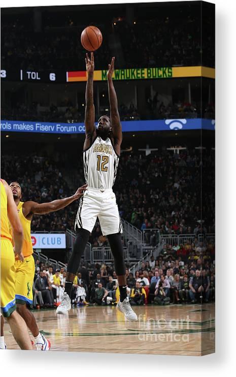 Nba Pro Basketball Canvas Print featuring the photograph Atlanta Hawks V Milwaukee Bucks by Gary Dineen