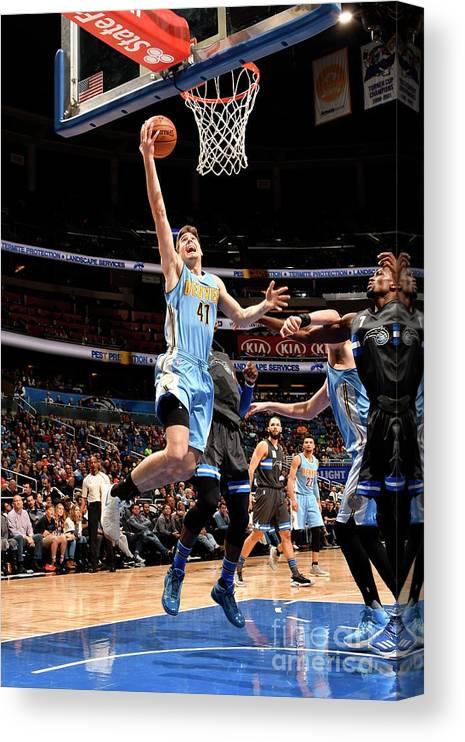 Nba Pro Basketball Canvas Print featuring the photograph Denver Nuggets V Orlando Magic by Fernando Medina