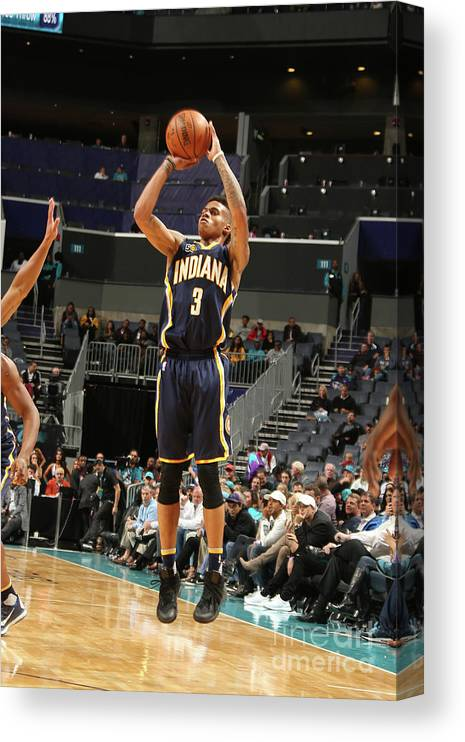 Nba Pro Basketball Canvas Print featuring the photograph Indiana Pacers V Charlotte Hornets by Kent Smith