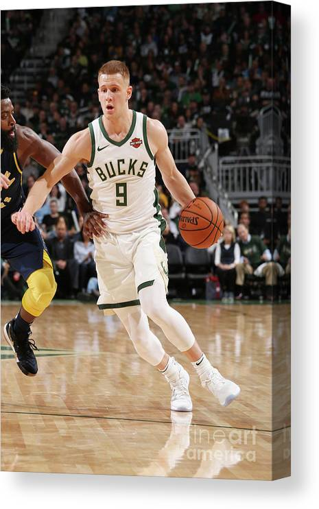 Nba Pro Basketball Canvas Print featuring the photograph Indiana Pacers V Milwaukee Bucks by Gary Dineen