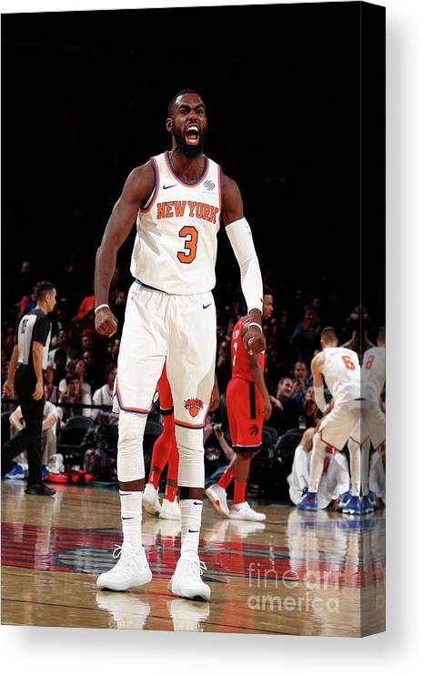 Tim Hardaway Jr. Canvas Print featuring the photograph Toronto Raptors V New York Knicks by Nathaniel S. Butler