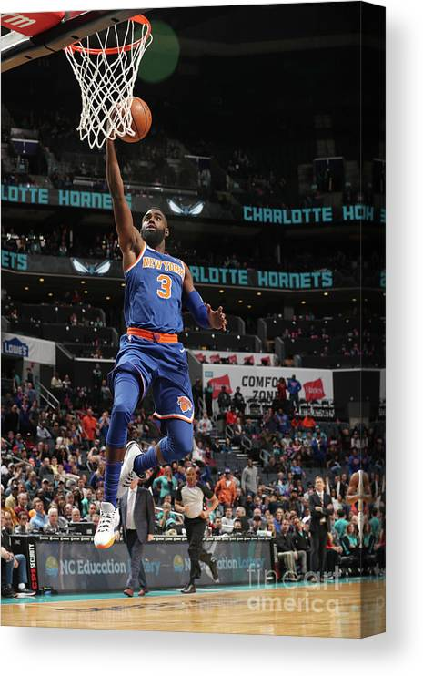 Tim Hardaway Jr. Canvas Print featuring the photograph New York Knicks V Charlotte Hornets by Kent Smith
