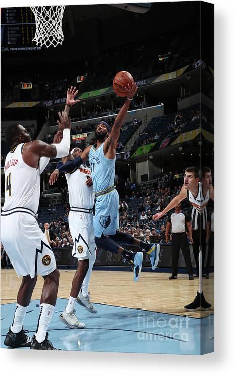 Nba Pro Basketball Canvas Print featuring the photograph Denver Nuggets V Memphis Grizzlies by Joe Murphy