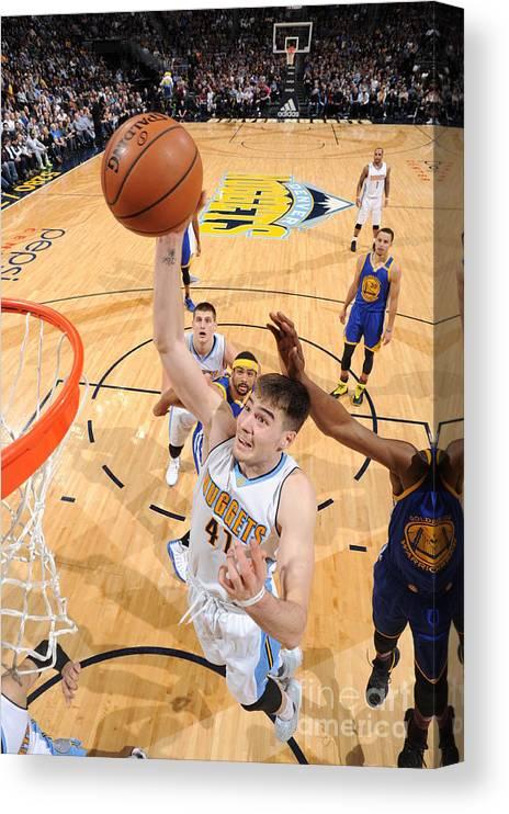 Nba Pro Basketball Canvas Print featuring the photograph Golden State Warriors V Denver Nuggets by Garrett Ellwood
