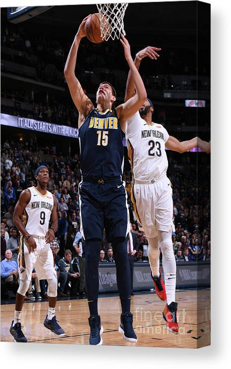 Nba Pro Basketball Canvas Print featuring the photograph New Orleans Pelicans V Denver Nuggets by Garrett Ellwood