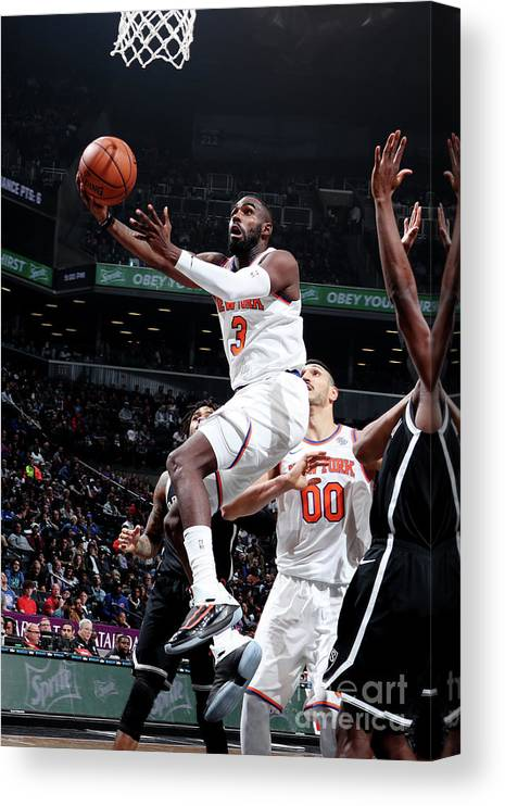 Tim Hardaway Jr. Canvas Print featuring the photograph New York Knicks V Brooklyn Nets by Nathaniel S. Butler