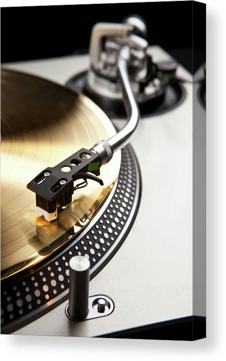 Music Canvas Print featuring the photograph A Gold Record On A Turntable by Caspar Benson