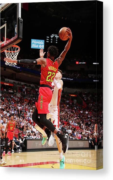 Nba Pro Basketball Canvas Print featuring the photograph Atlanta Hawks V Miami Heat by Issac Baldizon