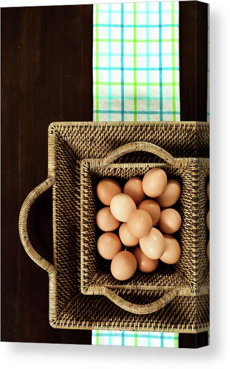 Large Group Of Objects Canvas Print featuring the photograph Basket Of Brown Eggs by Joey Celis