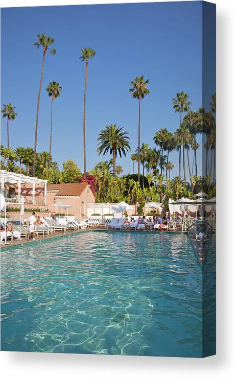 Tranquility Canvas Print featuring the photograph Blue-bottomed Pool Beneath Palm Trees by Barry Winiker