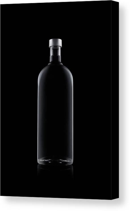Black Color Canvas Print featuring the photograph Bottle Of Water Isolated On Black by Kedsanee