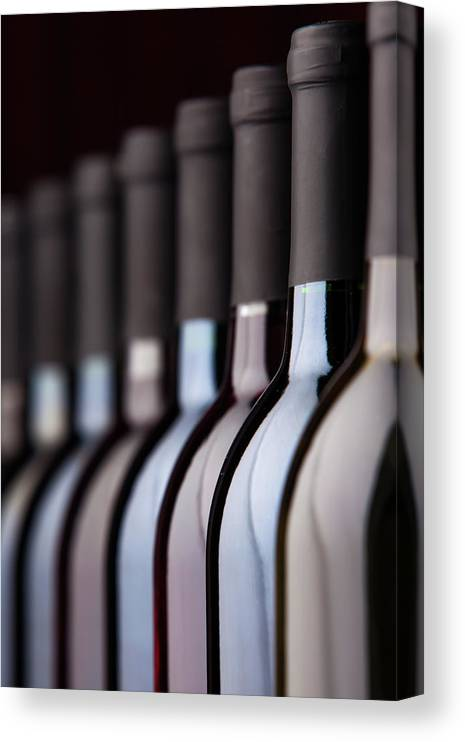 Alcohol Canvas Print featuring the photograph Bottles Of Wine In A Row by Halbergman