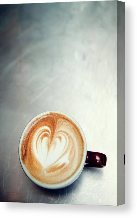 Spoon Canvas Print featuring the photograph Caffe Macchiato Heart Shape On Brushed by Ryanjlane