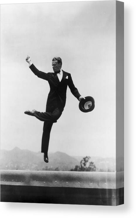 Wind Canvas Print featuring the photograph Cagney Leaping In Formal Attire by Getty Images
