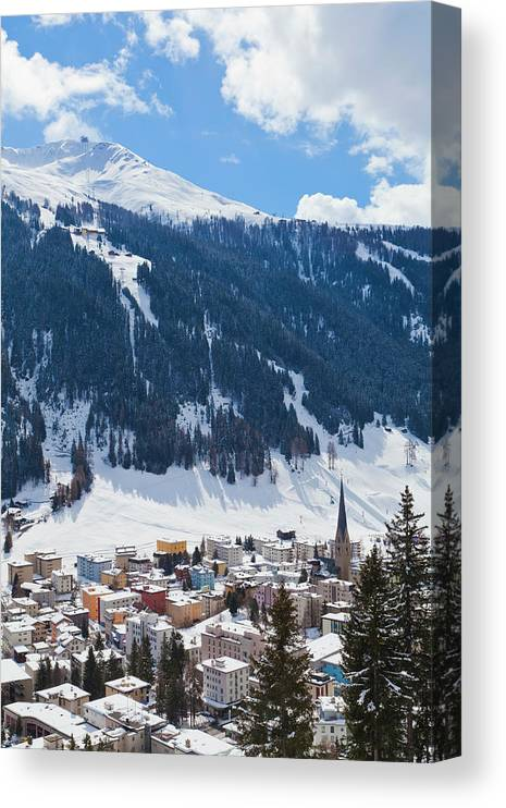Snow Canvas Print featuring the photograph Cityscape Of Davos, Grisons, Switzerland by Werner Dieterich