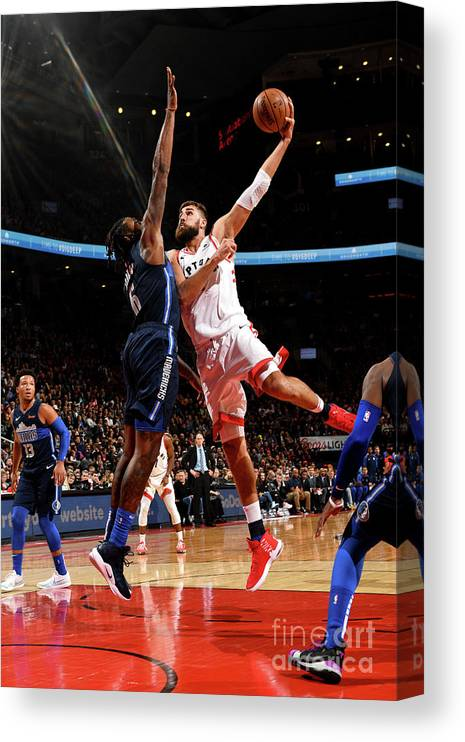 Nba Pro Basketball Canvas Print featuring the photograph Dallas Mavericks V Toronto Raptors by Ron Turenne