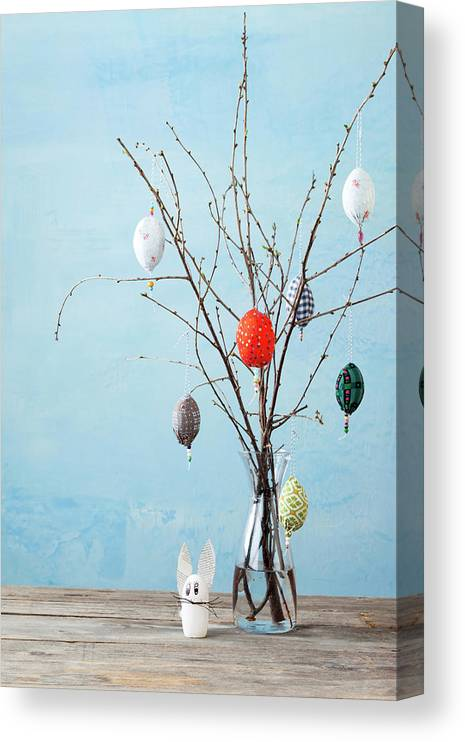 Holiday Canvas Print featuring the photograph Egg-shaped Decorations On Branches by Stefanie Grewel