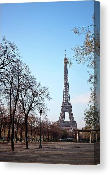 Built Structure Canvas Print featuring the photograph Eiffel Tower In Paris by Tuan Tran