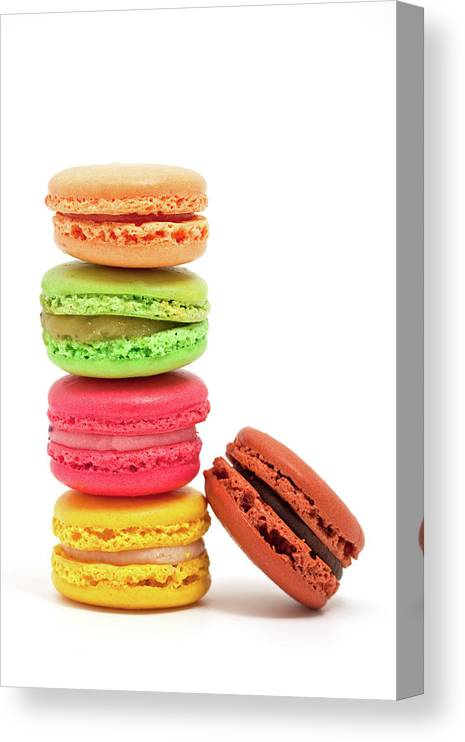 White Background Canvas Print featuring the photograph French Macaroons by Ursula Alter