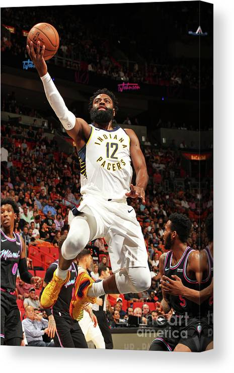 Nba Pro Basketball Canvas Print featuring the photograph Indiana Pacers V Miami Heat by Oscar Baldizon