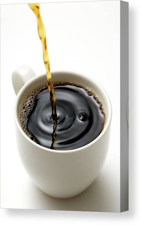 Breakfast Canvas Print featuring the photograph Isolated Shot Of Pouring A Fresh Coffee by Kyoshino
