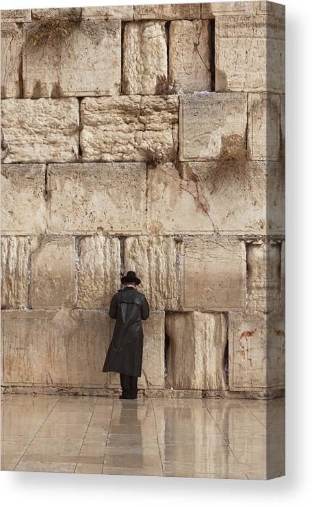 People Canvas Print featuring the photograph Jewish Man Praying On The Wailing Wall by Richmatts