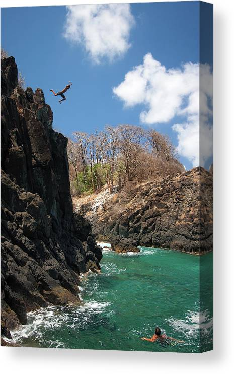 Tranquility Canvas Print featuring the photograph Jumping by Mauricio M Favero