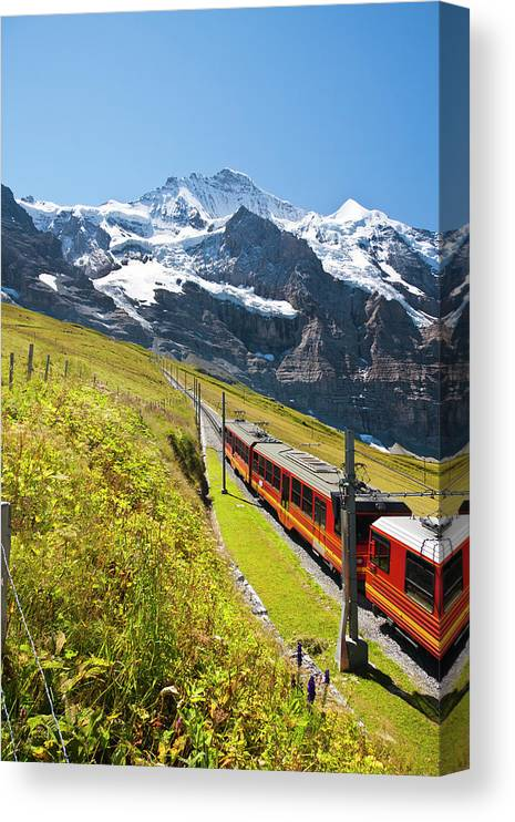 Scenics Canvas Print featuring the photograph Jungfraubahn, Swiss Alps by Michaelutech