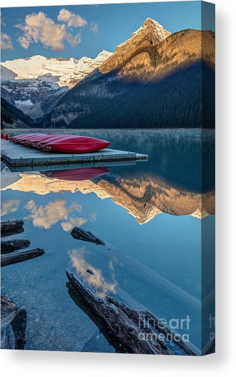Glaciers Canvas Print featuring the photograph Lake Louise Canoes In Banff National by Pierre Leclerc