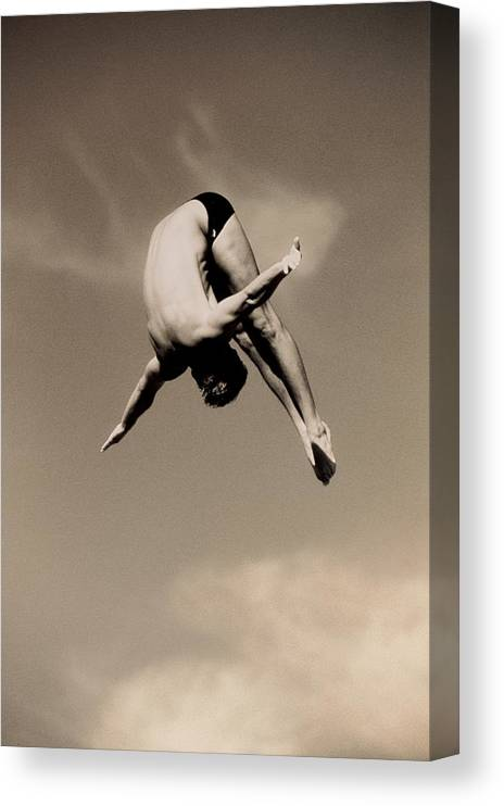 Diving Into Water Canvas Print featuring the photograph Male Diver In Mid-air by David Madison