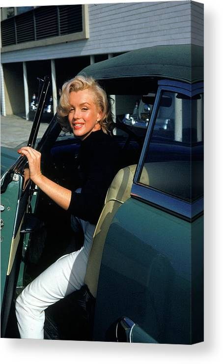 Marilyn Monroe Canvas Print featuring the photograph Marilyn Monroe Getting Out Of A Car by Alfred Eisenstaedt