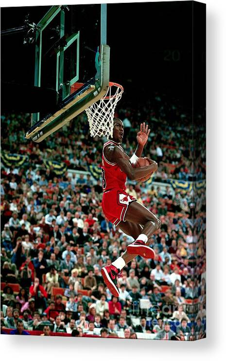 Chicago Bulls Canvas Print featuring the photograph Michael Jordan Competes In The Nba All by Andrew D. Bernstein