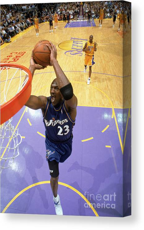 Nba Pro Basketball Canvas Print featuring the photograph Michael Jordan Goes Up For The Dunk by Andrew D. Bernstein