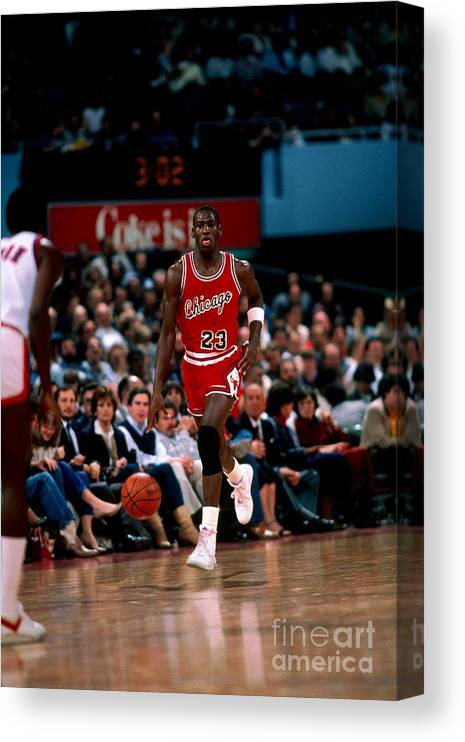 Chicago Bulls Canvas Print featuring the photograph Michael Jordan by Peter Read Miller