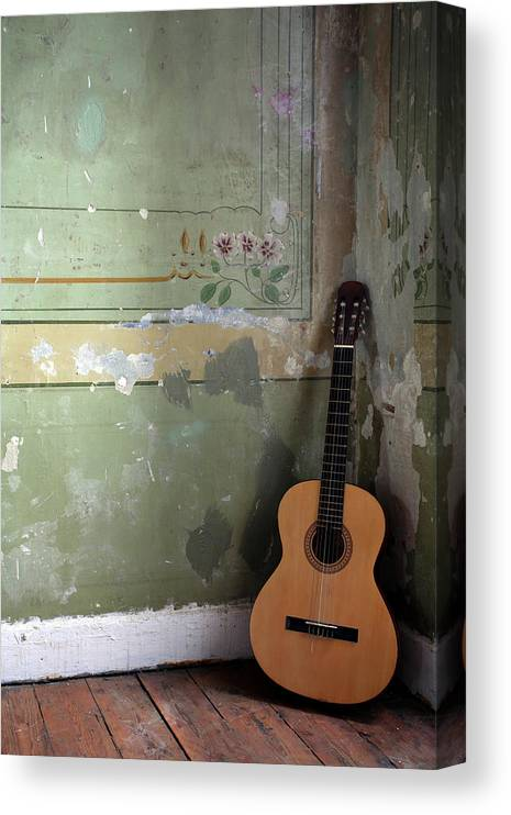 Music Canvas Print featuring the photograph Old Guitar by Kursad