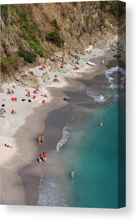Water's Edge Canvas Print featuring the photograph People Relax On Shell Beach by Holger Leue