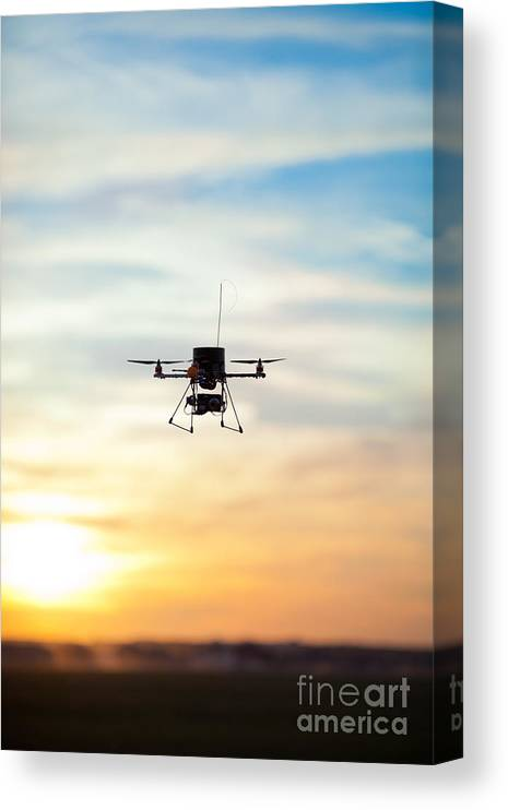 Sky Canvas Print featuring the photograph Picture Of A Quadrotor Rc Model by Glovatskiy