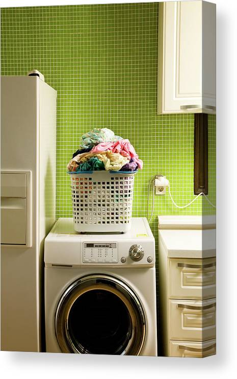 Washing Machine Canvas Print featuring the photograph Pile Of Laundry On Washing Machine by Jae Rew