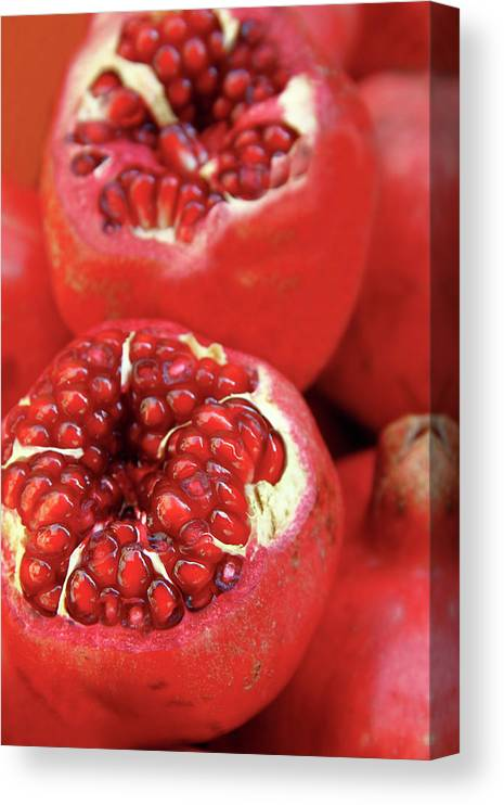 Fermenting Canvas Print featuring the photograph Pomegranates by Oonal