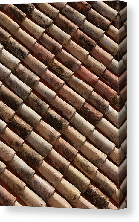 In A Row Canvas Print featuring the photograph Rooftop In Dubrovnik Old Town by Martin Child