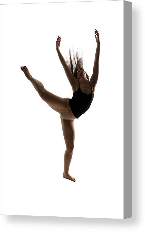 Ballet Dancer Canvas Print featuring the photograph Silhouette Of A Performing Dancer by Opla
