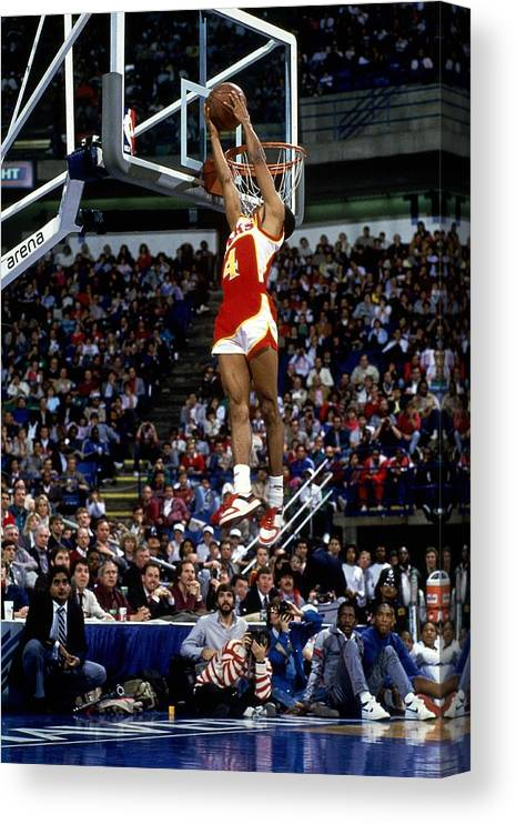 1980-1989 Canvas Print featuring the photograph Spud Webb Reverse Dunk Slam Dunk by Andrew D. Bernstein
