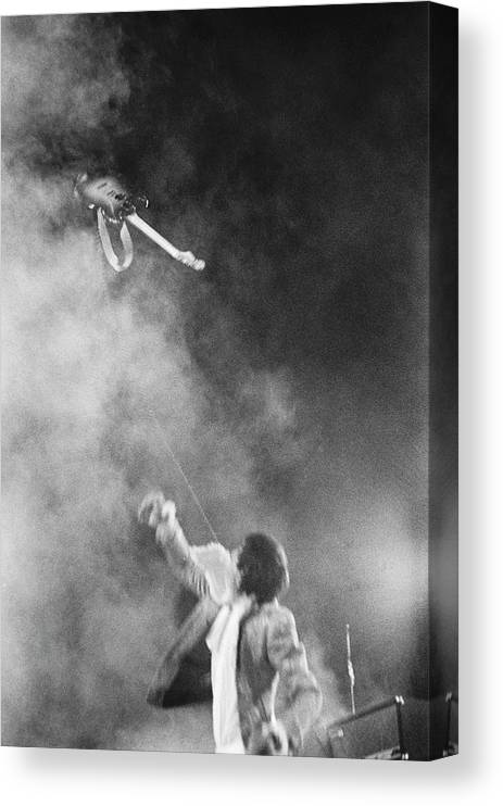 Rock Music Canvas Print featuring the photograph The Who Performing In Flint, Mi by Michael Ochs Archives