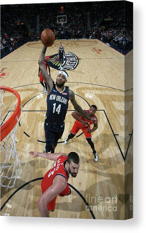 Smoothie King Center Canvas Print featuring the photograph Toronto Raptors V New Orleans Pelicans by Layne Murdoch Jr.