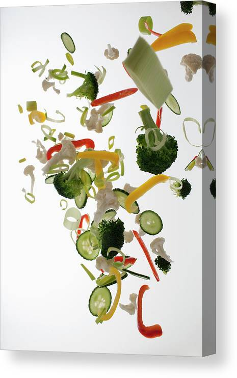 Broccoli Canvas Print featuring the photograph Vegetables Against A White Background by Dual Dual