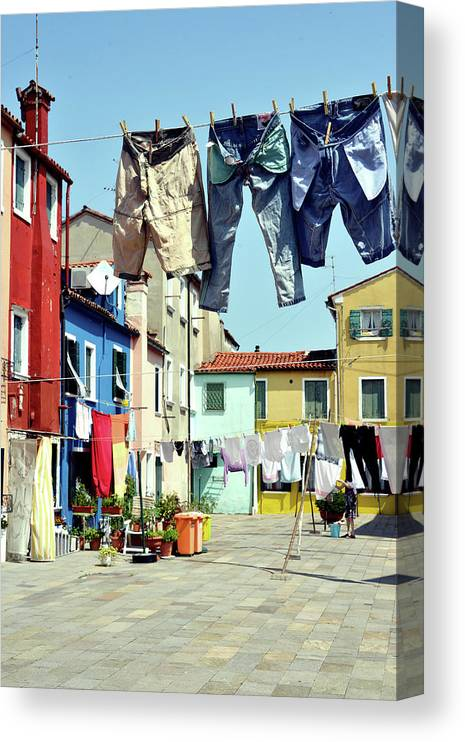 Hanging Canvas Print featuring the photograph Washday In Burano by Paul Biris