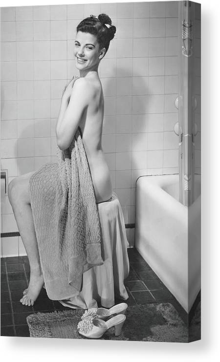Looking Over Shoulder Canvas Print featuring the photograph Woman Sitting In Bathroom, Covering by George Marks