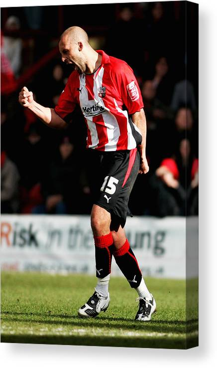 Scoring Canvas Print featuring the photograph Brentford v Gillingham by Dean Mouhtaropoulos
